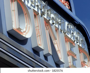 Sectional shot of neon diner sign detail.