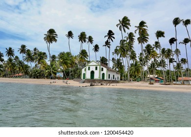 Secular Chapel of Carneiros Beach, Pernambuco, Brazil. Church in the beach among palms.