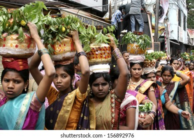 SECUNDERABAD,AP,INDIA-JULY 28:Hindu devotees carry the Bonam to the mahankali temple,as an offering to the goddess, during bonalu festival on July 28,2013 in Secunderabad,India.Annual festival event.