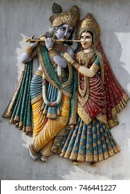 SECUNDERABAD,INDIA-OCTOBER 31:wooden carving art work of Sri Krishna and Radha on exterior panel in a Hindu temple on October 31,2017 in Secunderabad,India