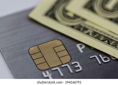 Secure chip of credit card cover with dollar banknotes, Macro shot.