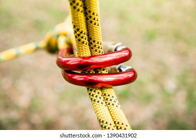 secure fastening of the rope to the climbing carabiner, carabiner in focus