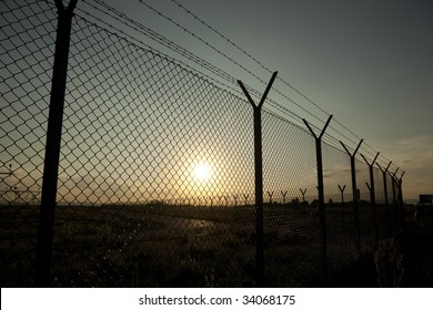 Secure fence at sunset