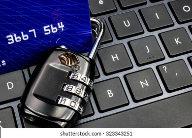 Secure online payment concept: Padlock and credit card on computer keyboard.