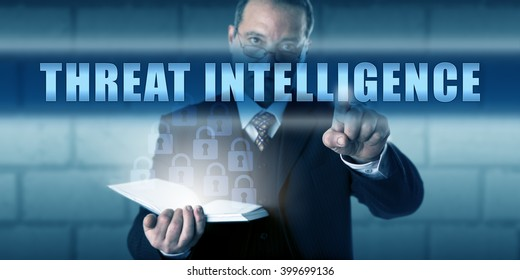 Security agent pushing THREAT INTELLIGENCE on a translucent touch screen. Business metaphor and computer security concept. Concentrated look across spectacles and decisive gesture with pointing hand.