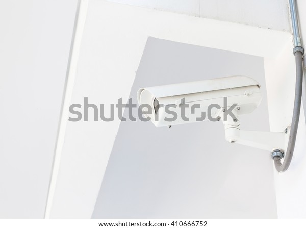 Security camera (CCTV ) on the wall