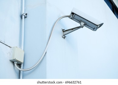 Security Camera, CCTV on white ceiling location Technician fixing video surveillance