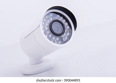Security camera with infrared light on gray background