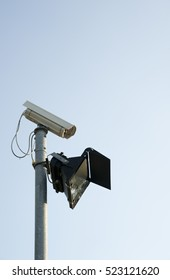 Security camera with a light on a pole