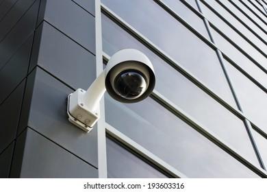 Security camera on modern building facade