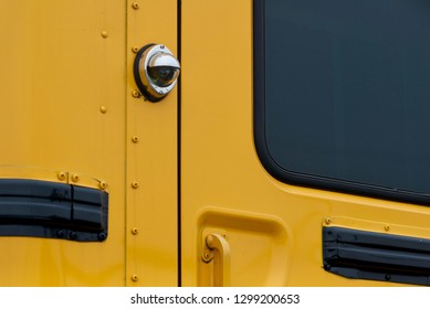 Security camera on side of a school bus.