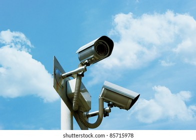Security camera on the sky background