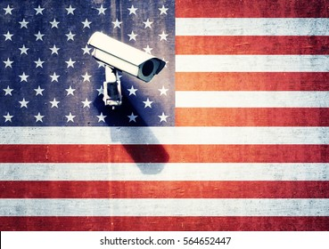 Security camera on the textured wall with painted United States of America flag. Conceptual relation policy with neighbors.