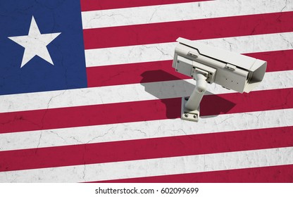Security camera on wall with painted Liberia flag background. Concept political relations with neighbors