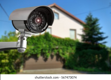 Security camera and private house on the background