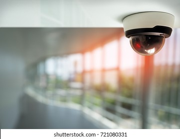security camera surveillance installed on ceiling to monitor for privacy and protection