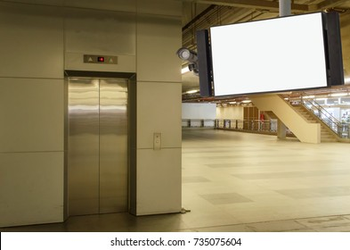 security camera and television blank screen or billboard, copy space for advertising or display media and content with elevator at subway train station or airport, commercial and marketing concept