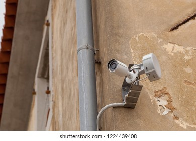 Security camera with wi-fi antenna on old house