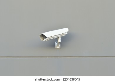 security camera working on the wall of a building