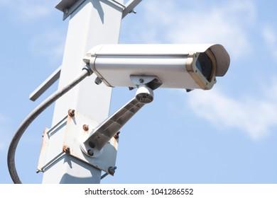 security cameras in garden on blue sky background