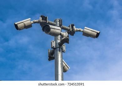 Security cameras on blue sky background.