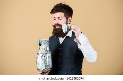Security and cash money savings. Man bearded guy hold jar full of cash savings. Start saving for your retirement as early as possible. Establish your budget. Businessman with his dollar savings.