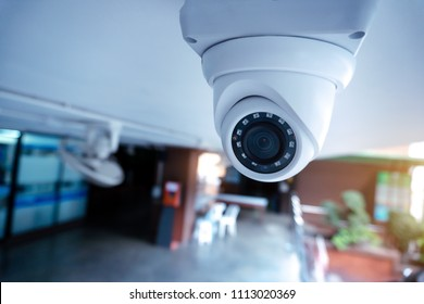 Security CCTV camera at the ceiling in area under of condominium.Anti-theft system and help create peace of mind.Digital eyes at parking lot.Modern technology.Surveillance.Infrared