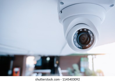 Security CCTV camera at the ceiling in area under of condominium.Anti-theft system and help create peace of mind.Digital eyes. Photography and video recording.Surveillance.Infrared