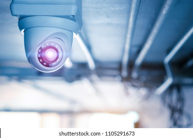 Security CCTV camera at ceiling in office building.Intelligent cameras can record video both day and night.Anti-theft system.Digital Eyes.Modern technology.Surveillance.Infrared.