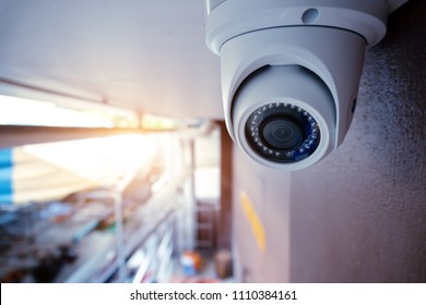 Security CCTV camera at ceiling in office building.Intelligent cameras.Photography and video recording.Anti-theft system.Digital Eyes.Modern technology.Surveillance.Infrared.