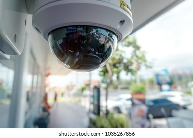 Security CCTV camera at front of Supermarket.Intelligent cameras can record video both day and night.Security System.Digital Eyes.Surveillance.Automated technology