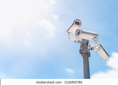 Security CCTV camera is installed in three directions at post on sky background.Anti-theft system and help create peace of mind.Digital eyes. .Surveillance.Infrared.Technology