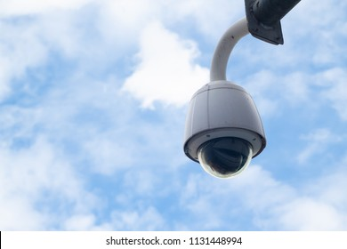 Security, CCTV camera panorama with blue sky and cloud, copy space