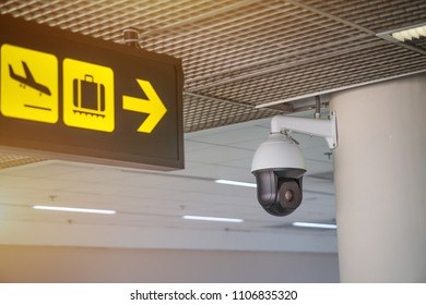 Security CCTV camera or surveillance system in  Airport. Closed-circuit television. with sign in the airport.