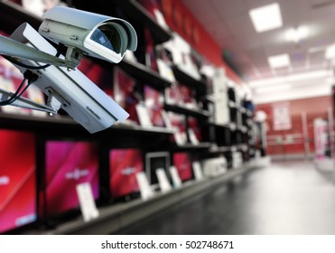 security CCTV camera or surveillance system with shop tv on blurry background