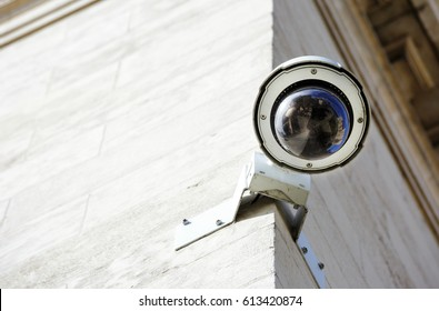 security CCTV camera or surveillance system fixed on old construction wall