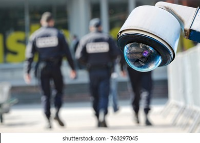 security CCTV camera or surveillance system with military on blurry background