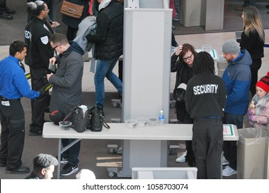Security Checkpoint and control in Toronto, Canada - March 24 2018: Scanning Machines, People's Bags Getting Checked.