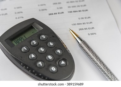 Security Code Calculator And Pen On Financial Document