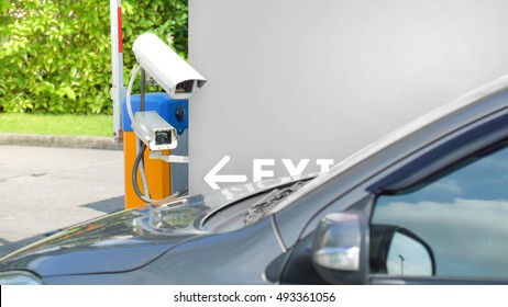 Security equipment concept - CCTV camera video surveillance on car parking at guard house safety system area control and copyspace