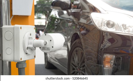 Security equipment concept - CCTV camera surveillance on car parking Safety system area control with flare light and copy space