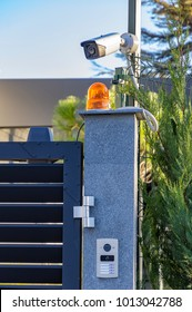Security equipment - lamp, camera and video intercom, in the entry of a house. Technology and security