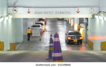 Security equipment and parking concept - Blurred gate of basement parking and car with copyspace