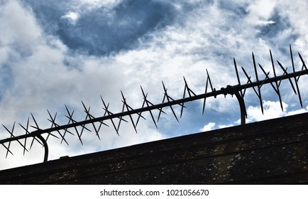 Security fence on  sky background