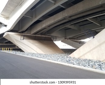 security fences under Wilson bridge with street and rocks