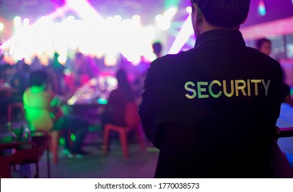 Security guard bouncer are regulating the situation of safety in an event concert in a nightclub.