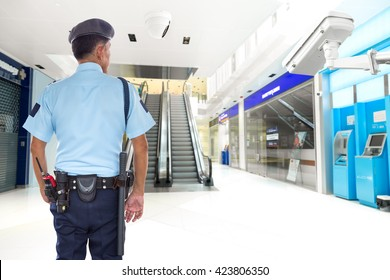 Security guard and CCTV in the elevator lobby, ATM banknote office building
