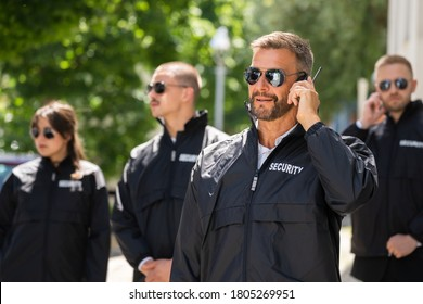Security Guard Event Service. Officer And His Group - Shutterstock ID 1805269951