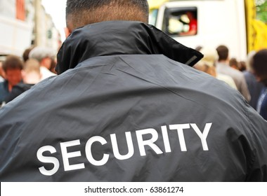 security guard in front of crowd