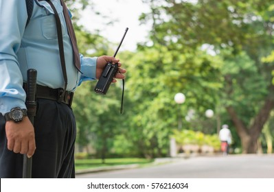 Security guard hand holding cb walkie-talkie radio,copy space.